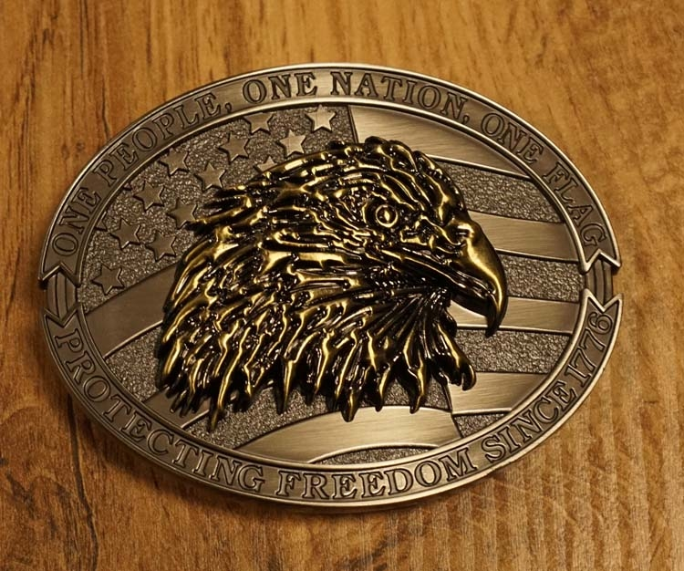 """Belt buckle  """" One people one nation.  one flag """""""