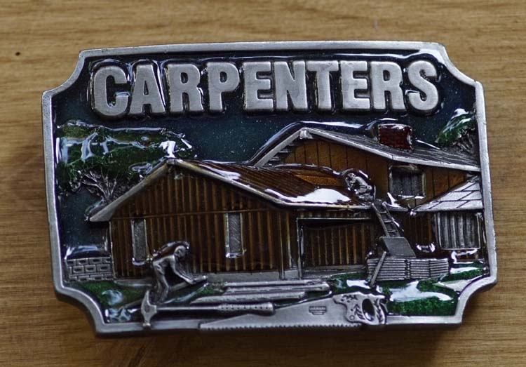"Decorative buckle  "" Carpenters ""   (  Zimmermann )"